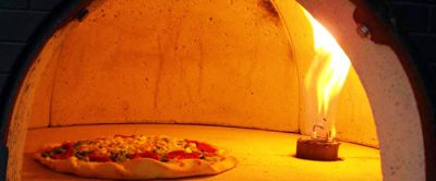 Lenha ou gás: qual o melhor forno para pizzaria?